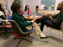 african american students meeting with their teacher